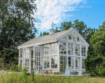 A picture of a backyard greenhouse