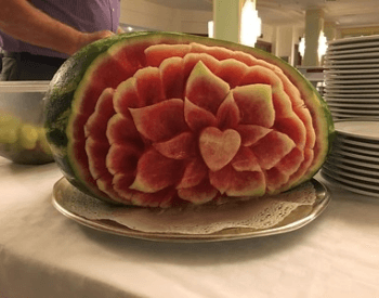 A picture of a watermelon with a beautiful carving
