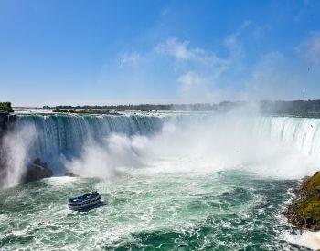 A picture of a boat near Niagara Falls waterfall