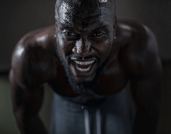 A picture of a man sweating from working out