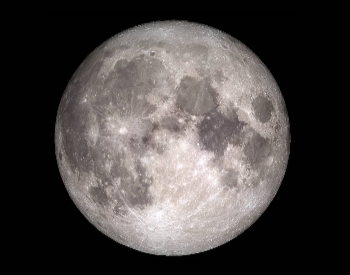 A photo of a rare full moon on Christmas Day.