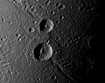 An amazing photo of two craters on the surface of Dione.