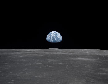 A picture of the earth from the surface of the moon.
