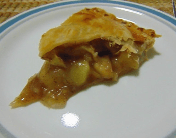 A picture of a slice of apple pie