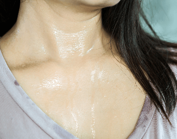 A picture of a woman sweating from the heat