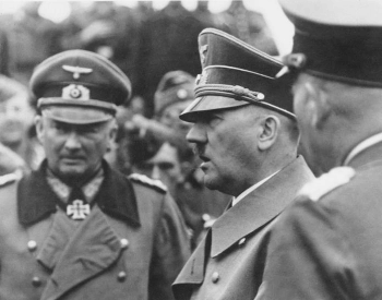 A picture of Adolf Hitler inspecting his troops in France.