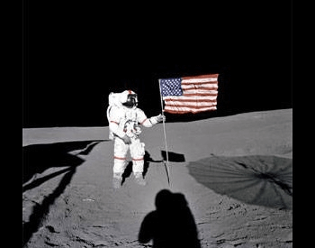 A photo of Alan Shepard walking on the moon during the Apollo 14 mission