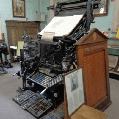 A picture of an early printing press