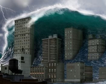 An illustration of a city being hit by a tsunami