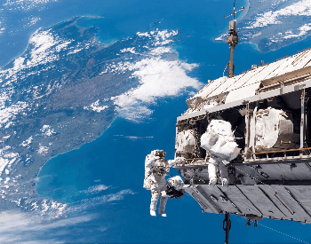 A picture of astronauts doing an EVA outside the ISS Space Station