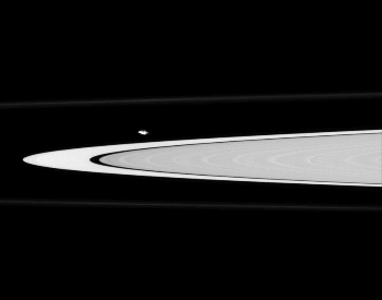 A photo of Atlas ouside of one of Saturn's rings
