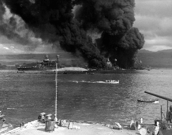 A picture of Battleship Row after the Japanese attack on Pearl Harbor