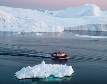 A picture of a boat sailing through the Arctic Ocean