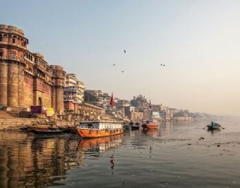 A picture of boats and buildings on the Ganges River