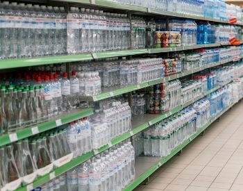 A picture of water bottles sold in a grocery store