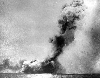 A picture of the British Battle Cruiser HMS Queen May exploding at the Battle of Jutland