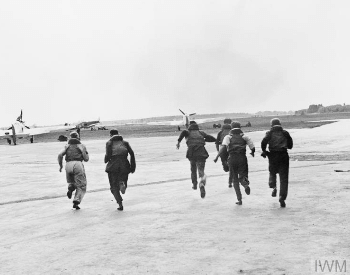A picture of British pilots scrambling to their planes