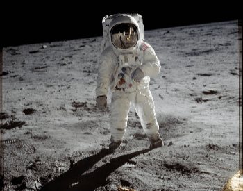 A photo of Buzz Aldrin walking on the surface of the moon during Apollo 11