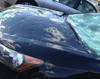 A car damaged by hail