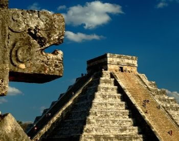 A picture of Chichen Itza and a stone statue