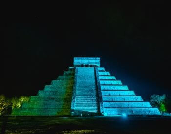 A picture of Chichen Itza during the nighttime