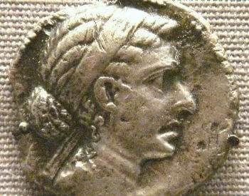 A picture of Cleopatra's face on a silver coin