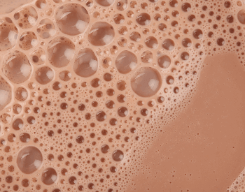 A close-up picture of chocolate milk in a glass