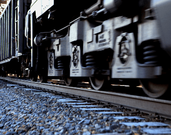 A close-up picture of train wheels on train tracks