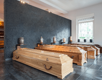 A picture of some coffins in a funderal home