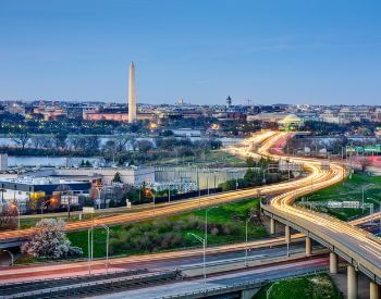 A picture of the Washington Monument and the DC skyline