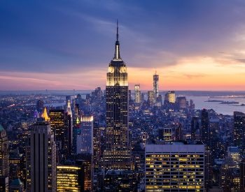 A picture of the Empire State Building at sunset