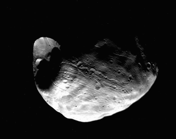 The first photo of the moon Phobis from NASA Viking 1