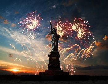 A picture of fireworks around the Statue of Liberty