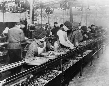 A picture of the Ford assembly line in 1913