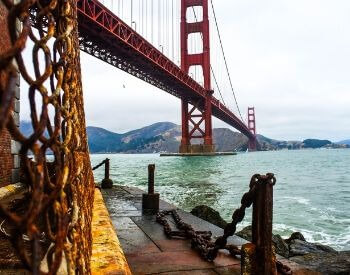 A picture of the Golden Gate Bridge from the ground level