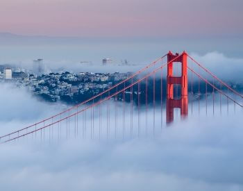 A picture of the Golden Gate Bridge on a very foggy day