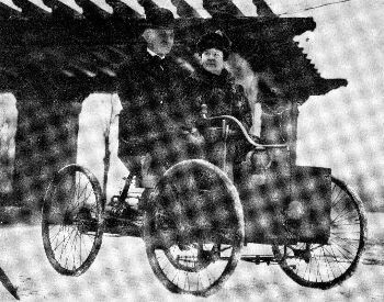 A picture of Henry Ford and his wife on a Quadricyle