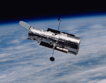 A photo of the NASA Hubble Space Telescope in above Earth in orbit