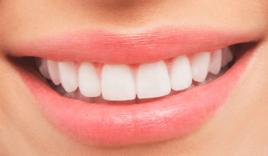 A close-up picture of the front teeth of a human