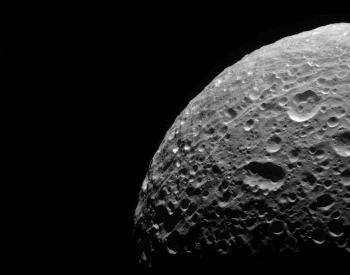 A photo of the moon Mimas showing impact craters