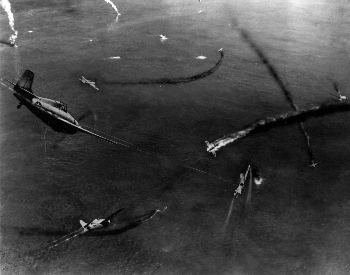 A photo of Japanese and American aircraft fighting in the air