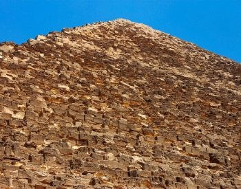 A picture looking up at an Egyptian Pyramid