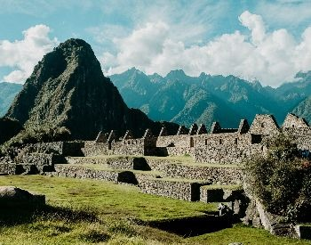 A picture of Machu Picchu with the Andes Mountains in the background