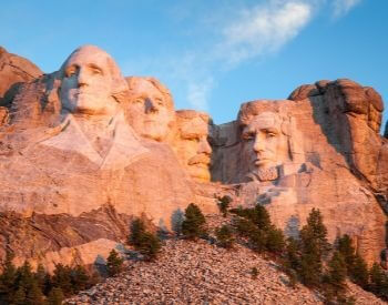 A beautiful picture of Mount Rushmore as the sun is rising