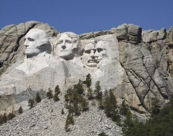 A picture of Mount Rushmore from the highway that passes it