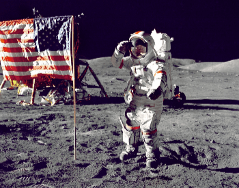 A photo of Neil Armstrong by the American Flag on the surface of the moon