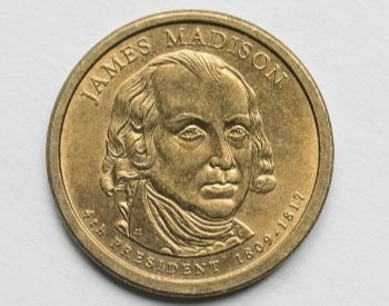 A picture of a U.S. one dollar coin with James Madison