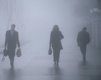 Multiple People Walking in Fog
