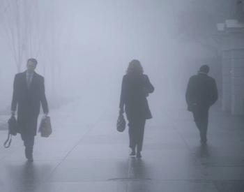 Multiple People Walking in Fog