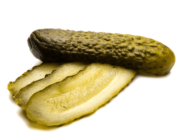 A picture of a pickled sliced in half